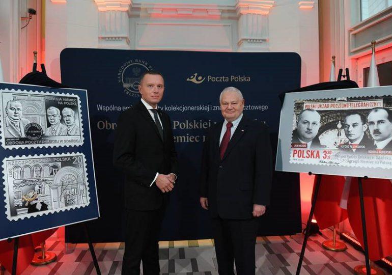 """Polska: Prezentacja monety - """"Obrona Poczty Polskiej w Gdańsku. Agresja Niemiec na Polskę"""""""